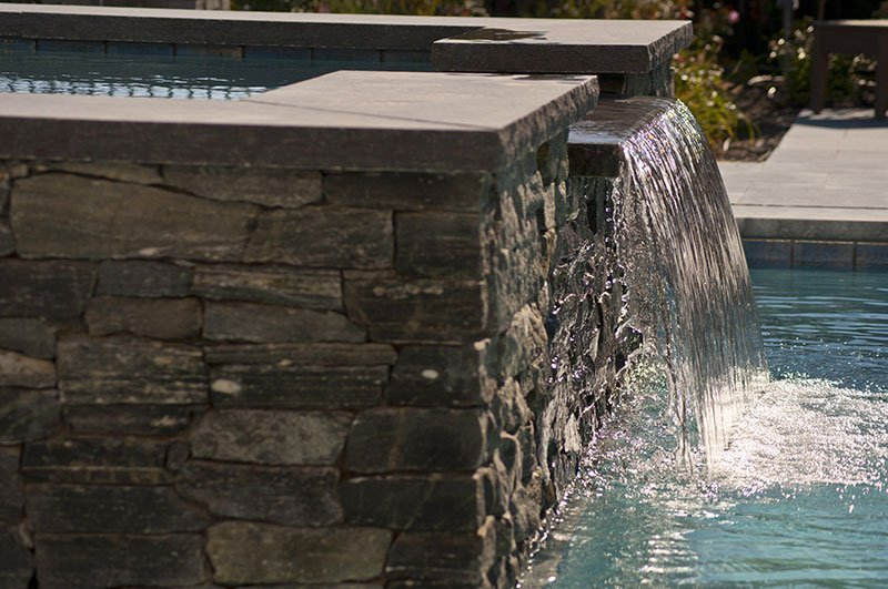 Cape Cod pool waterfalls by Shoreline Pools