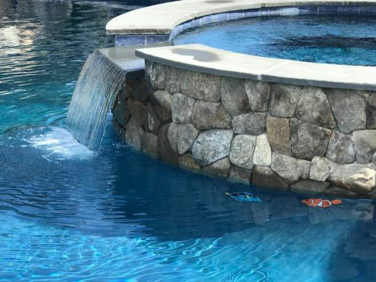 Custom spillover swimming pool feature