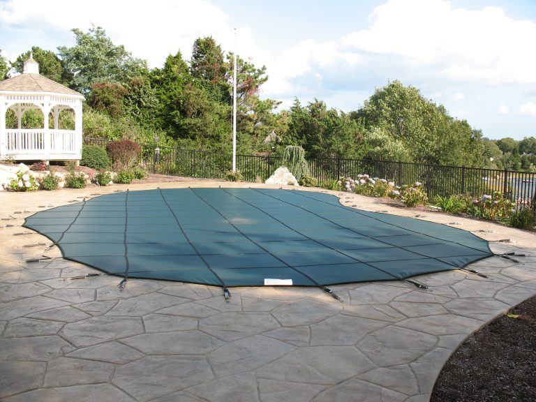 A custom Cape Cod pool cover for winter safety