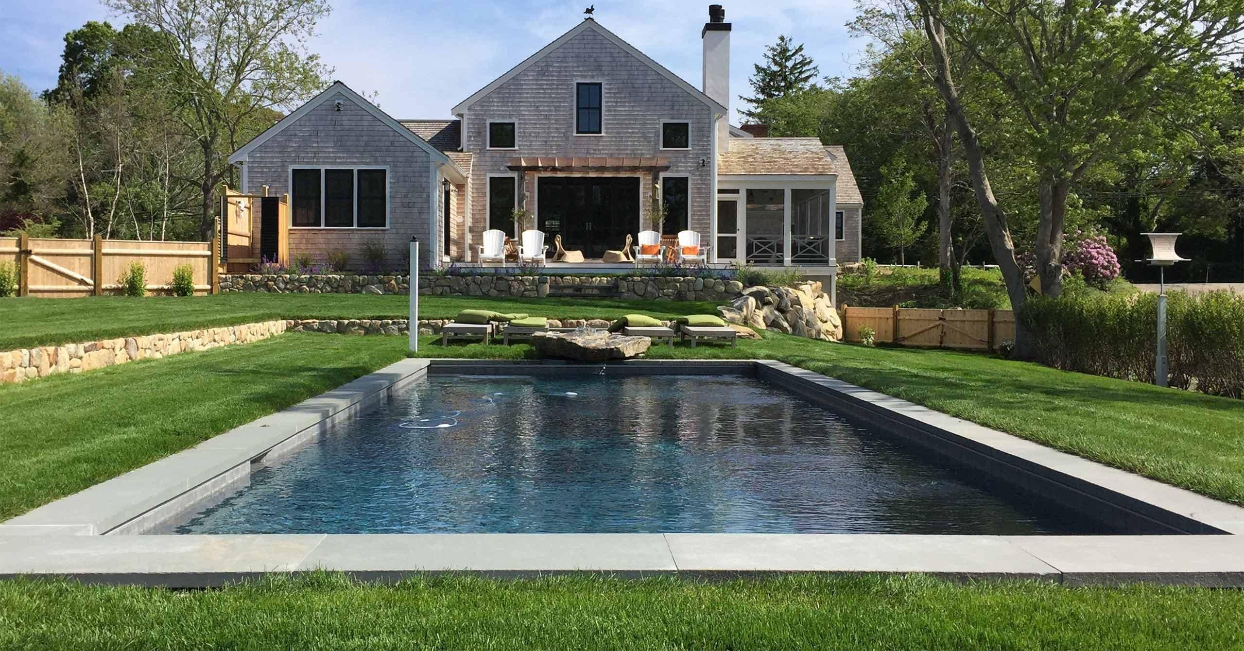 Pool set into ground with grass around it