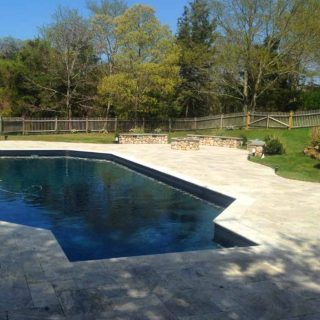 Pool renovation with outdoor firepit and new hardscaping