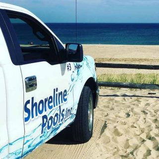 Shoreline Pools truck at teh beach on Cape Cod