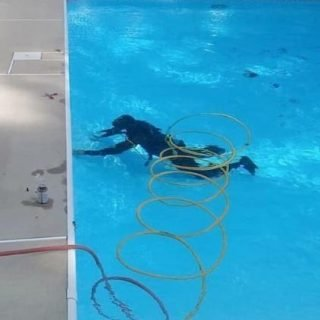 Leak detection specialist underwater with scuba gear