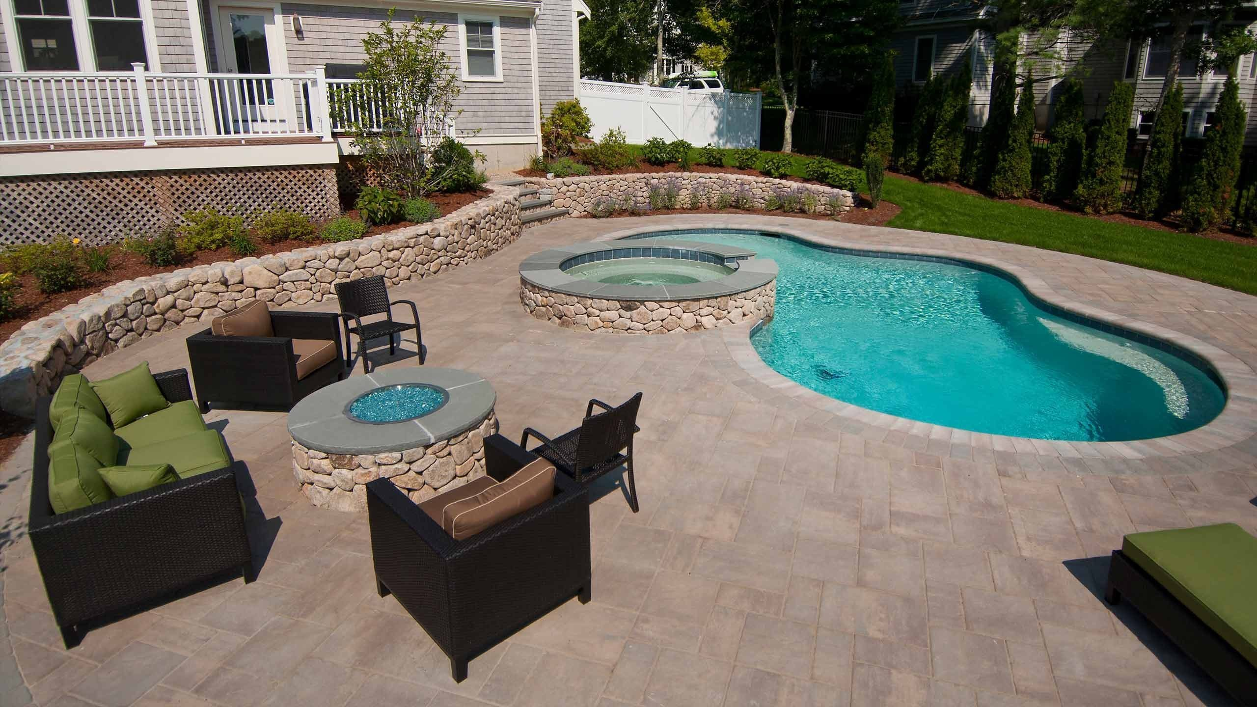 Cape Cod swimming pool with backyard firepit